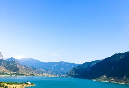 clear sky over a lake in the Caucasus. Lake and mountains of the Caucasus against a clear blue sky. Dagestan mountains. hydroelectric power station in the mountains 写真素材