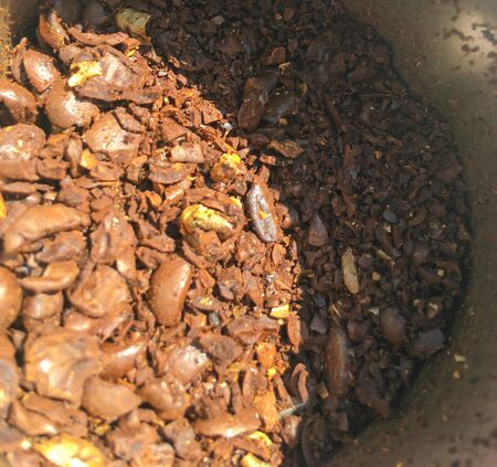 Macro photo of freshly ground coffee in an electric coffee grinder.The fried coffee beans lie in a coffee grinder.