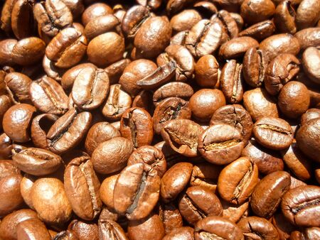 roasted coffee beans, can be used as background. large grains of coffee