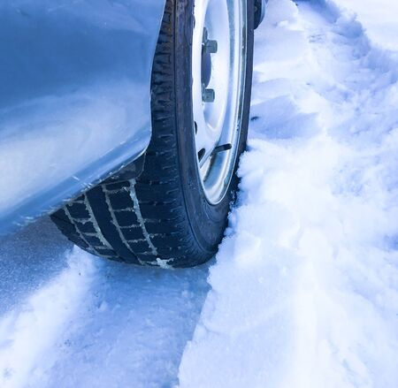 Winter tires on a snowy road. Tires in the snow. Machine parts.