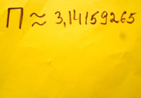 The number pi is written in a notebook with a pen or marker. Pi day number concept. pi is 3.14