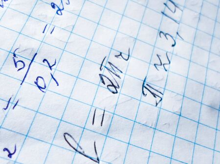 pi day - pi sign and other mathematical formulas are written in a notebook for the holiday of March 14, top view 写真素材