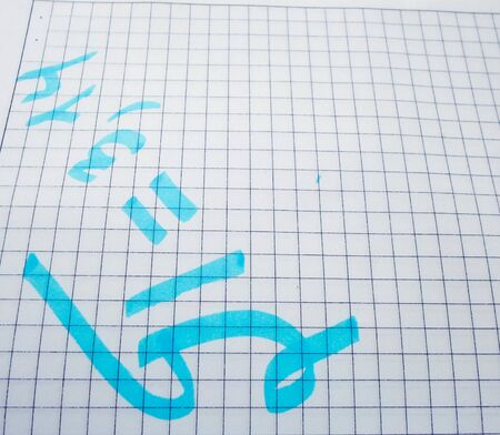 pi day - pi sign is written with a pen and marker for the holiday of March 14, on a white background, top view, copy space.