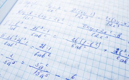 mathematical formulas are written in a notebook. solution school examples in algebra and geometry Stok Fotoğraf - 138827339