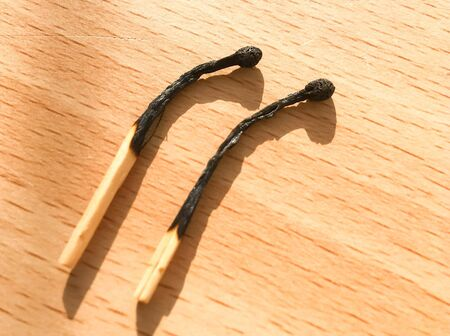 Matches on a wooden background, macro photo. Close-up shot. Matches lie on a wooden table.