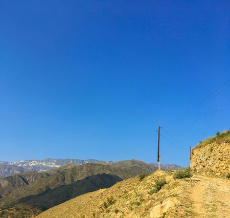 Caucasus mountains. Dagestan. Trees, rocks on a background of blue sky 스톡 콘텐츠