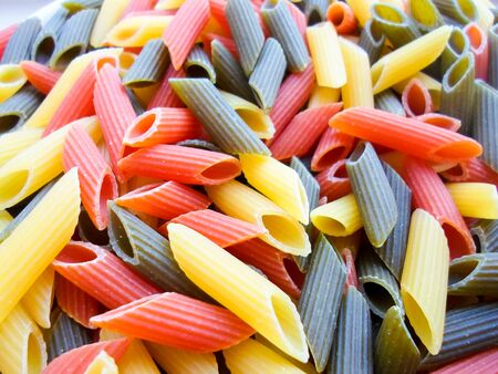 colored pasta for dinner. background photo of beautiful pasta. many multi-colored mokoron in a ringlet