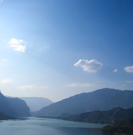 clear sky over a lake in the Caucasus. Lake and mountains of the Caucasus against a clear blue sky. Dagestan mountains. hydroelectric power station in the mountains 스톡 콘텐츠