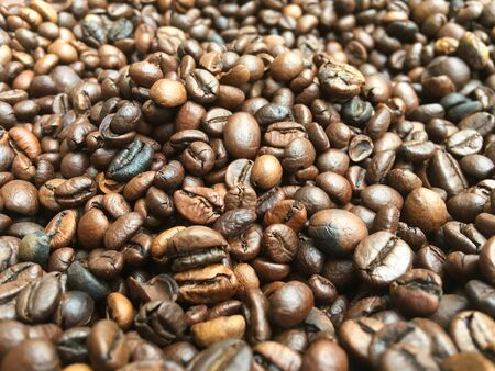a bunch of coffee beans are lying on the table. coffee texture and background image