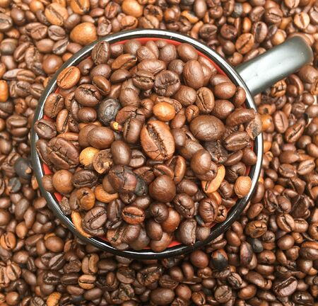 a bunch of coffee beans are in a glass and on the table. coffee texture and background image