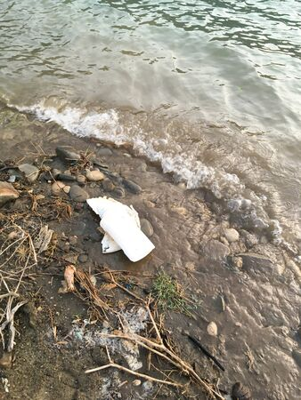 Ecological problem of pollution of plastic debris in the ocean. Pollution of plastic bottles of water in the ocean environmental concept