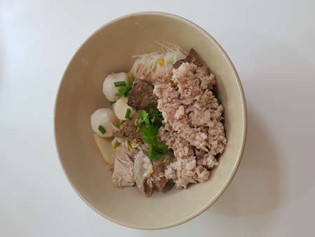 Dry noodles with meat Animal offal, meatballs, line in the cup, white background