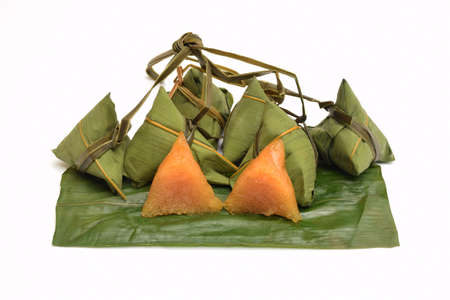 Steamed sticky rice wrapped in bamboo leaves on white background