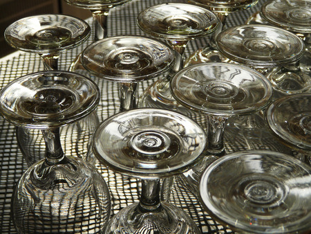 upturned: Upturned wineglasses on counter bar Stock Photo