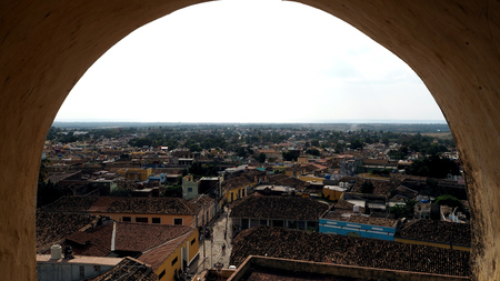 View through the arc of the clocktower in the city of Trinidad, Cuba.