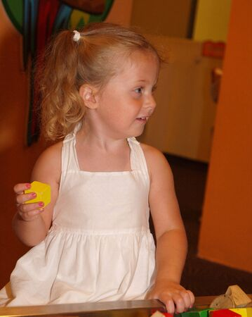plating: Photo image of a little girl plating with blocks