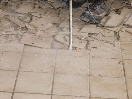 Photo image of ceramic tile floor demolition during homw renovations