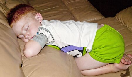 inocent: Inocent little redheaded boy napping