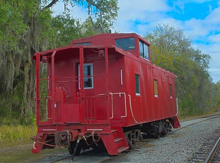 caboose: Hrd photo im age of a red caboose Stock Photo