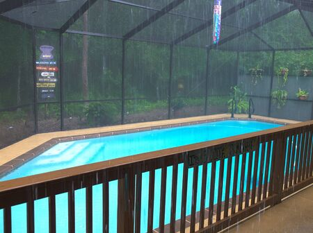 HDR photo of a rainy day at poolside