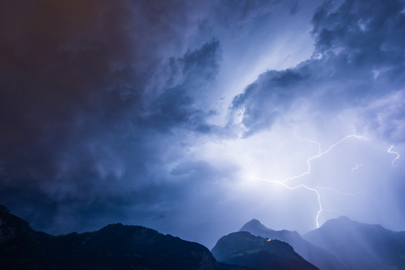 Lightning over the mountains, long exposure. Stock Photo