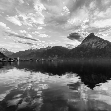 white clouds: Mountain panorama. Clouds are reflected on the lake Blurred background. Black & white