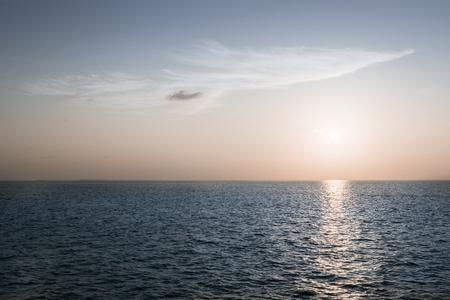 bypass: Sunset over the ocean. Maldives. Bleach Bypass effect Stock Photo