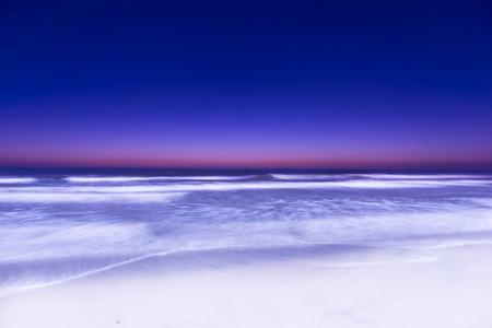Night Surf Ocean Beach in San Diego. Long exposure.