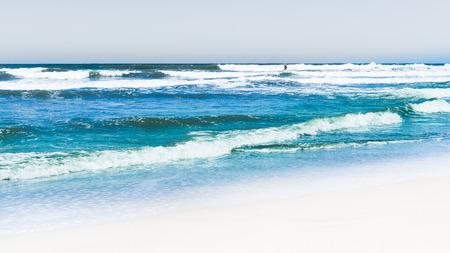 Sandy beach, the surf of the ocean. California.