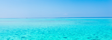 Ocean view. In the sky a few clouds. Turquoise water of the lagoon. Reklamní fotografie