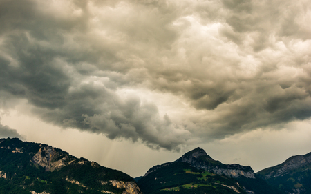 Heavy storm clouds over the mountain peaks. Filter soft light. Photo, abstract landscape Stock Photo