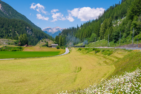 Journey by the historic steam  train to Grisons, Swiss Alps