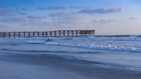 California coast. San Diego beach at sunset. Ocean Waves rolled on the sand Stock Photo