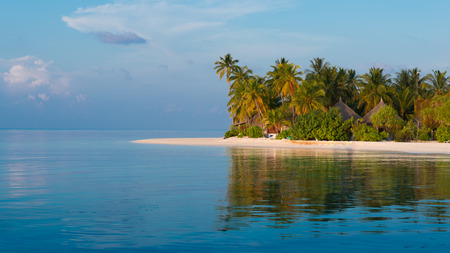 Panorama of a tropical island with a white sand beach and turquoise water of the ocean. Landscape l with palm trees. Stock Photo