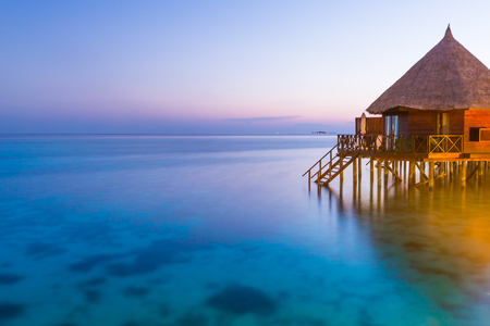 Fantastic color of sunset on a tropical island. Relax evening in the Maldives. Long exposure