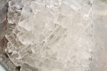 Ice cubes in blender machine close up Stock Photo