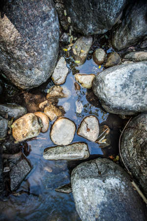 A lot of stone in the water photo