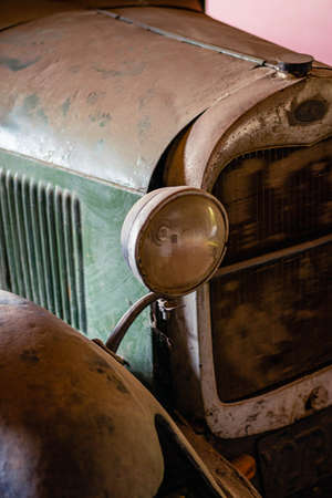 old abandoned car with two lamps