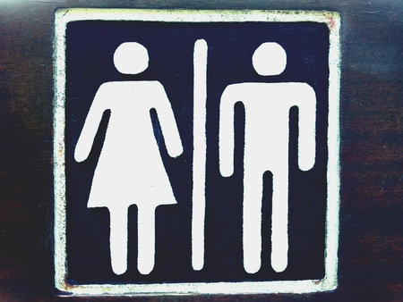 man: Women and man restroom sign