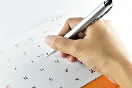 hand woman checking meeting plan in calendar.