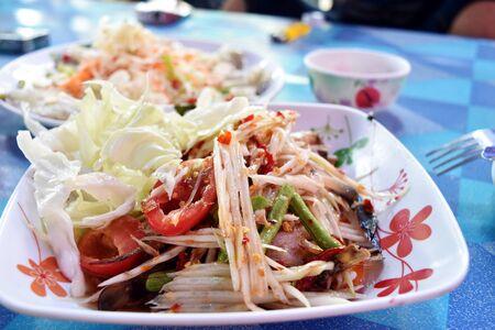 peppery: Papaya salad in dish on table, Thai food, Thailand Stock Photo