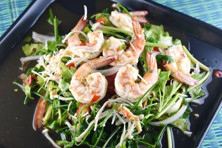 Spicy shrimp salad with vegetable in dish, thai food.
