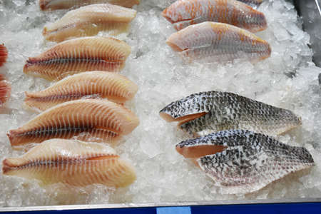 fish in ice: Fresh fish on ice in market