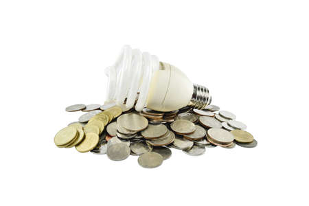 vitreous: Coins heap with light bulb (energy savings concept) on white background with clipping paths. Stock Photo