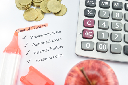 pen quality: element of Cost of Quality on white paper with money, pen and calculator. concept for business.