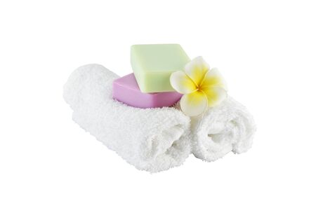 white towels: Spa treatment with soap towels and flower on white background with clipping paths Stock Photo