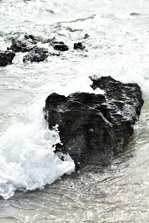 waves crashing: Sea waves crashing onto rocks(Typical seascape)