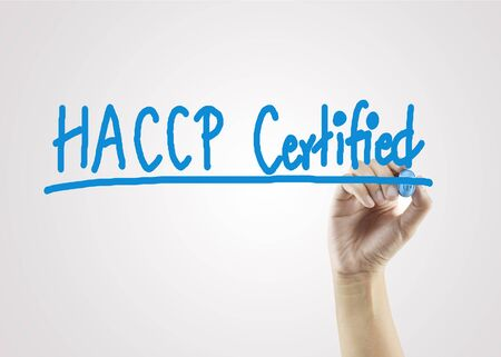 certify: women hand writing HACCP certified (Hazard Analysis of Critical Control Points) concept on gray background for business strategy  and used in manufacturing.