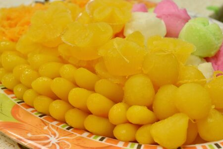 Colorful appearance and distinct flavors have unique of thai sweets or thai dessert on plate. Stock Photo