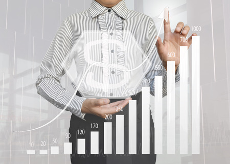 Businesswoman pointing at growing graph concept for business success, investment, financial, future technology and money, profits and assessed.